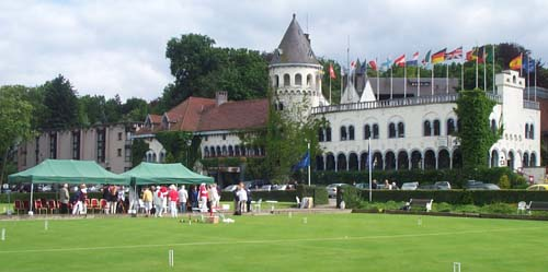 Photo of Hotel Chateau du Lac with croquet lawns in foreground.