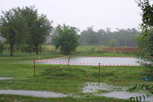 Photo of one of the Busto Arsizio croquet lawns near Milan completely submerged in rainwater.